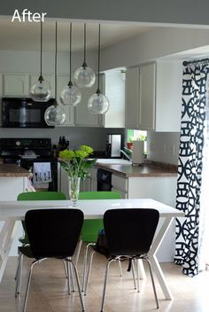 A newish cookie cutter home gets a kitchen facelift with paint and a stunning new light fixture. The before shot is the standard track home kitchen.