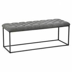 """Coffee table with a button-tufted linen top and iron frame.  Product: Coffe tableConstruction Material: Iron and linen Color: Stone wash graniteFeatures: Button -tufted Dimensions: 18"""" H x 58"""" W x 28"""" D"""