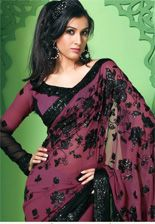 If you see any saris like this in India (bold deep colors, whatever that work is called, long sleeved, relatively simple) can you get it for me?