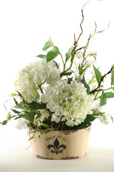 Features:  -Maintenance and allergy free.  -For home or office.  -Assembled in the USA.  Product Type: -Floral Arrangements.  Flower: -Hydrangeas.  Container Finish: -Inovy.  Size: -Large.  Seasonal T