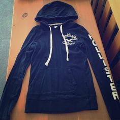 Form fitting Hollister hoodie In great condition. Size small. Navy blue long sleeve. Hollister Tops Sweatshirts & Hoodies