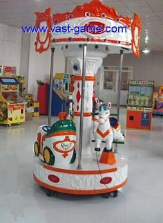 Looking for the carousel ride kiddy ride game machine for your kids? We are providing coin operated kiddie rides game machine for your kids. To get this, please call +86-020-22172925 or visit our website vast-game.com to know more about this product. Video Game Machines, Kids Ride On, Carousel, Cool Kids, Carnival, Coins, Website, Cool Stuff, Sports