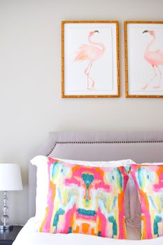 Colorful and bright apartment decor — fun pillows and flamingo prints by Inslee.