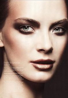Dark smokey eyes and dark metallic bronze lips, dramatic evening makeup inspiration. More Great Looks Like This