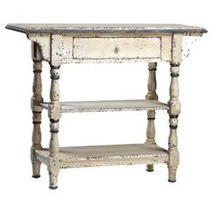 """Arrange country-chic accents and family photos on this side table, featuring a warmly weathered finish with blue accents, 2 shelves, and a drawer.  Product: Side tableConstruction Material: Asian fir and MDFColor: Distressed white and greyFeatures: One drawerDimensions: 30"""" H x 35"""" W x 14"""" DCleaning and Care: Dust with a soft cotton cloth"""