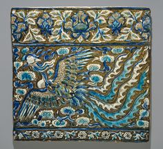 Tile with Image of Simurgh (Phoenix)  Object Name: Tile from a frieze Date: late 13th century Geography: Iran, probably Takht-i Sulaiman  Medium: Stonepaste; modeled, underglaze painted in blue and turquoise, luster-painted on opaque white ground  Dimensions: H. 14 3/4 in. (37.5 cm) W. 14 1/4 inl (36.2 cm)