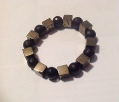 QUALITY+Organic/Natural+Faceted+Black+Onyx+beads+and+Pyrite+Squares.++Great+worn+alone,+paired+with+a+watch+or+stacked+with+other+Bead+bracelets.+  Available+Sizes+Include: 7+inches 7.5+inches 8.0+inches  Unisex 10+mm+beads