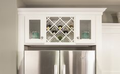 Built-in wine storage over refrigerator Wine Storage Cabinets, Kitchen Storage, Kitchen Cabinets With Wine Rack, Wine Rack Cabinet, Wine Racks, Cupboards, Kitchen Redo, Kitchen Remodel, Kitchen Ideas