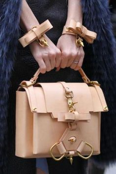 Phil Oh for Vogue street shot, Paris Fashion Week, February 2012 Details to look out for...
