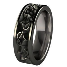 Amore titanium wedding ring - designed with a deeply carved celtic heart knot to symbolize endless love. Finished with our glossy black diamond plating for added resistance to every day wear