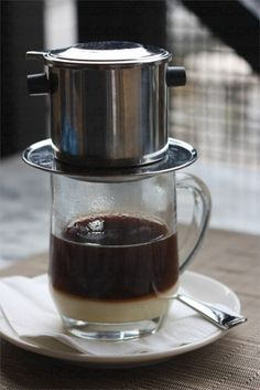 Vietnamese Coffee is made at the table with a special filter. It uses French roast coffee with chicory and is dripped onto a bed of sweetened condensed milk. It is great hot or cold.