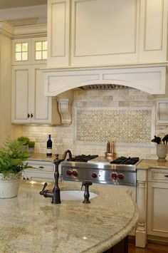 Monochromatic creams for cabinets, countertops and backsplash... Love!