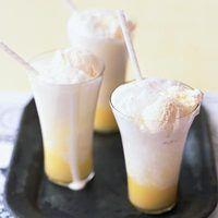 Lemon Cream Soda (1 cup of lemon curd, 1 liter bottle sparkling water, chilled, 8 scoops vanilla ice cream)