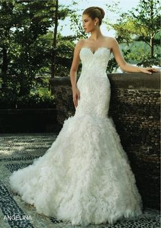 Intuzuri 2013 wedding dresses - this is pretty! Not sure if I could pull it off but I like this