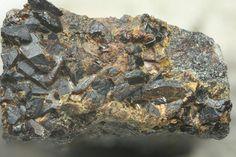 Garyansellite, (Mg,Fe+++)3(PO4)2(OH,O)•1,5(H2O), Rapid Creek, Yukon, Canada. Sharp brown garyansellite crystals on matrix