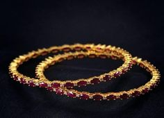 Elegant pair of bangles adorned with fine burmese rubies and diamonds with open settings is surely a must have for every wardrobe !!!
