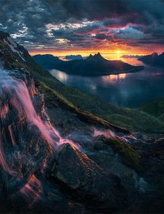 A waterfall high above the fjords of Norway during the Midnight Sun…. by maxrivephotography