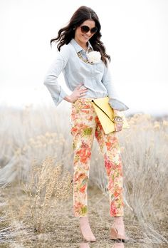 this beautiful floral print orange trouser has a small button and pocket the size is medium large x-large it costs twenty pounds