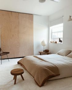 One off pieces and brown on brown tones in the harmonious bedroom of artist and designer Kirill Bergart.