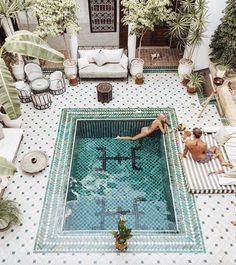 Glazed green tiles, planting galore and glasses of fizz pool side. That's the alfresco dream right there.