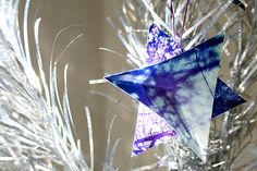 Scissor & Fold Photos into Origami-like Ornaments! (And you probably already have everything you need to make them.)