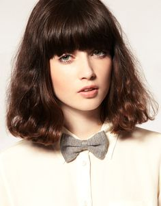 soft brown hair, fluffy angled long bob and heavy bang. Exactly what I DON'T want my hair to look like.