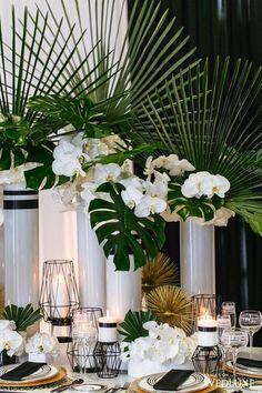white and green tropical wedding centerpiece ideas #tropicalwedding #weddingdecor #weddingideas #weddingreception #weddingtable