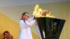 Torchbearer Kian Steel lights the cauldron with the Olympic Flame after the Torch arrives at Baxters Park in Dundee during Day 25 of the London 2012 Olympic Torch Relay.