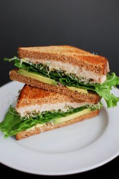 White beans are pureed with lemon juice and used as a healthy alternative to mayo on this white bean and avocado sandwich!