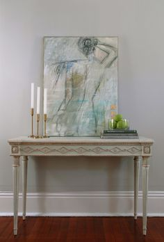 """The Aria Console features stunning hand carved floral details, a pearl detailed apron, and fluted legs. The finish is comprised of an ethereal blue and antique whites. An elegant piece for any entry way or dining room. The Aria Console looks ideal flanked with the Aria Side Chair.   • 33""""H x 50""""W x 19.5""""D • Swedish Blue finish with light patina  • Hand crafted and finished • Hand planed top and light distressing • Shipped with legs detached"""