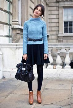 full skirt with tights, sweater and belt -- retro feel with sleek styling.  Would not wear contrast shoes.  Color scheme is a bit odd in this but like the overall proportion.