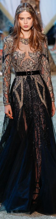 Fall 2017 Haute Couture: Black and gold coruscating long sleeved opulent Elie Saab gown #sparkle...x