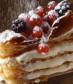 """Millefoglie Wedding Cake...when in Rome..or actually Tuscany ::  means """"Thousand Leaves."""" The name is fitting considering the many layers of cream puffs and fruit embedded in the core."""