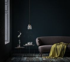 Minimal interior design idea. A beautiful gray sofa with two modern bedside tables