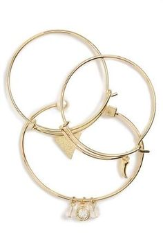 A trio of slim, shining goldtone bangles is set with luminous faux pearls, sparkly rhinestones and dangling metal charms. Color(s): gold multi. Brand: TOPSHOP. Style Name: Topshop Assorted Bangles (Set Of 3). Style Number: 5192964. Available in $18.00 by nordstrom
