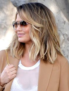 Chrissy Teigen's blunt, choppy lob is chock-full of movement and texture—perfect for girls with wavy hair. Her swoop of bangs only adds to the off-duty vibe.