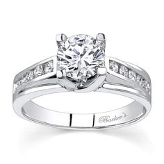 White Gold Engagement Ring - 7358LW - Modern and unique this diamond enagement ring sports a white gold stepped shank.  A round diamond center is secured by prongs evolving from the shoulders and a cathedral ridge rises up in the center with channel set diamonds adorning the top for a dazzling look of sophistication.  Available in yellow gold, 18k and Platinum.