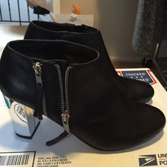 Dolce vita boots Black brand new dolce vita boots/ 8 1/2/ side zip/ mirrored heel/ rounded toe Dolce Vita Shoes Ankle Boots & Booties