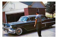 This photo was taken June 1, 1958 as Elvis dropped an army friend Rex Mansfield off at his parents' house in Memphis after they both completed basic training.  Elvis was driving his 1957 Cadillac limousine.