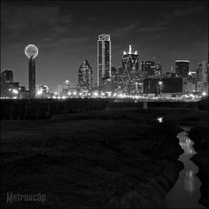 Black and White picture of Dallas Skyline at night from the Trinity River flloodplain.