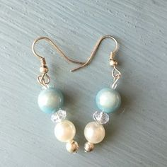 I just added this to my closet on Poshmark: Blue and Pearl Dangle Earrings. Price: $8 Size: OS