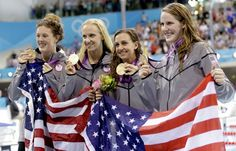 United States' 4 x 100-meter medley relay team from left, Allison Schmitt, Dana Vollmer, Rebecca Soni and Missy Franklin pose with their gold medals at the Aquatics Centre in the Olympic Park during the 2012 Summer Olympics in London, Saturday, Aug. 4, 2012.