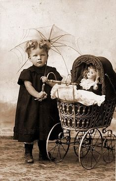 girl & doll in a carriage,
