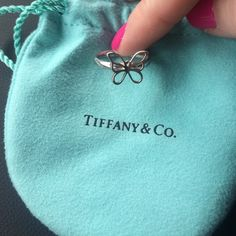 Tiffany and Co Butterfly ring Authentic. Size 5.5. Just picked up from a cleaning at Tiffany and Co at the mall. There is some wear on the band, hard to picture, but still in really great condition. They do not sell this ring  anymore. The stamp from Tiffany is shown on inside of ring in picture  Tiffany & Co. Jewelry Rings
