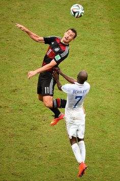 Thomas Muller of Germany against Damarcus Beasley of the USA