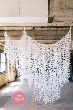 20 DIY wedding ideas - DIY Wax Paper Backdrop. Easily create this romantic backdrop with wax paper and string.