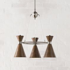 "Ibsen 3 conical-shaped light mini Chandelier by Langley Street; $178.50; distressed koa (also in white) & brushed nickel finish; 21""Hx20""Wx20""D; overall H min.29"", max. 65"";  also comes as a 5 light pendant; allmodern.com"