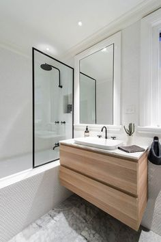 TOP 10 minimal & NATURAL bathrooms Bathroom with light wood and black trim. White tile bathroom with clear glass. Marble Bathroom with white and black, White Bathroom Tiles, Wood Bathroom, Laundry In Bathroom, Bathroom Renos, Bathroom Layout, Modern Bathroom, Small Bathroom, Modern Shower, Mirror Bathroom