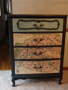 This vintage French provincial dresser was painted in duck egg blue and graphite and the drawers were decoupaged with a Paris map!