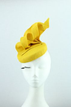 Yellow straw fascinator